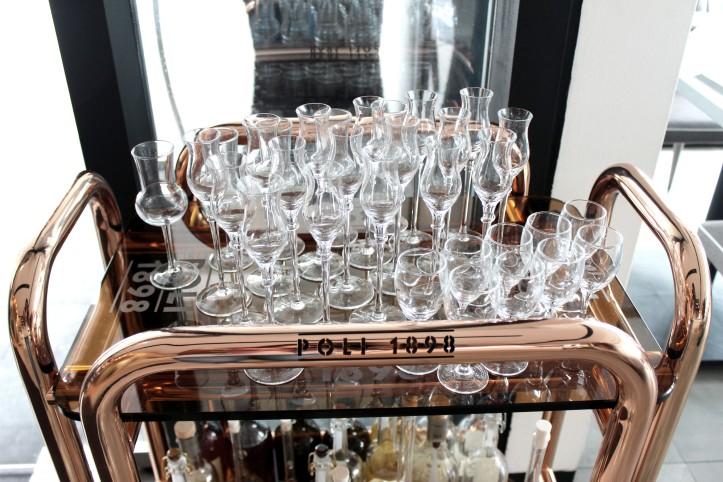 Image of glasses arranged neatly on tray.